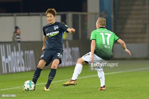 Genki Haraguchi of Hertha and Uffe Bech of Hannover battle for the ball during the HHotelscom Wintercup match between Hertha BSC and Hannover 96 at...