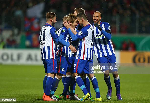 Genki Haraguchi of Hertha Berlin celebrates scoring his side's third goal during the DFB Cup quarter final match between 1 FC Heidenheim and Hertha...