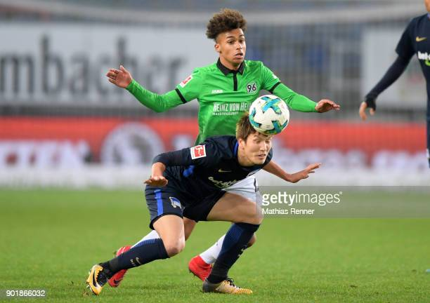 Genki Haraguchi of Hertha BSC and Linton Maina of Hannover 96 during the HHotelscom Wintercup match between Hertha BSC and Hannover 96 at Shueco...