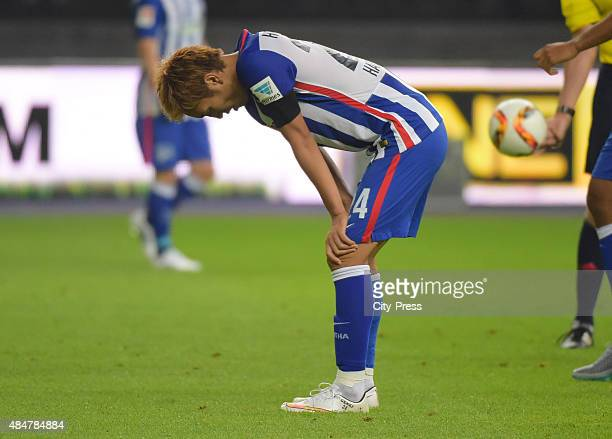 Genki Haraguchi of Hertha BSC is exhausted during the game between Hertha BSC and Werder Bremen on August 21 2015 in Berlin Germany