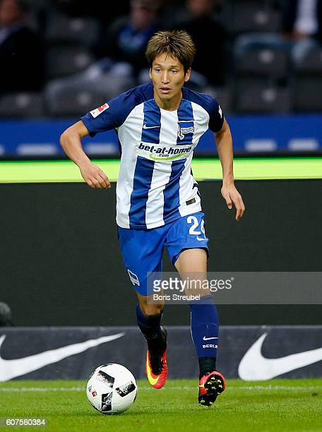 Genki Haraguchi of Hertha BSC runs with the ball during the Bundesliga match between Hertha BSC and FC Schalke 04 at Olympiastadion on September 18...