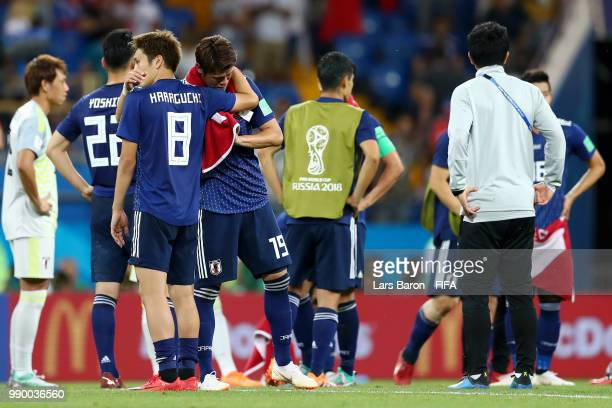 Genki Haraguchi of Japan and Hiroki Sakai of Japan look dejected following their sides defeat in the 2018 FIFA World Cup Russia Round of 16 match...