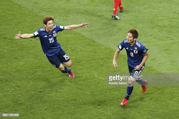 Genki Haraguchi of Japan and his teammate Yuya Osaka celebrate after Haraguchi scored their team's opener during the second half of a World Cup...