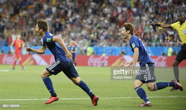 Genki Haraguchi of Japan and his teammate Yuya Osako celebrate after Haraguchi scored their team's first goal during the second half of a World Cup...