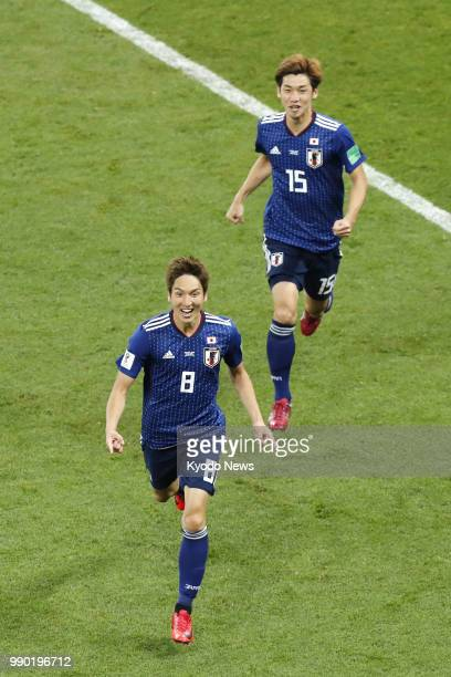 Genki Haraguchi of Japan celebrates along with his teammate Yuya Osako after Haraguchi scored a goal during the second half of a World Cup roundof16...
