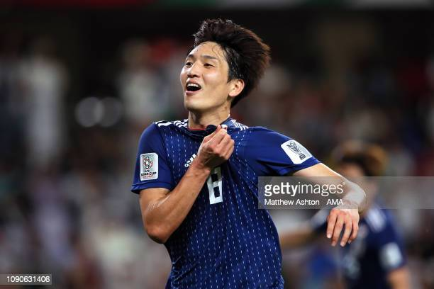 Genki Haraguchi of Japan celebrates scoring a goal to make it 0-3 during the AFC Asian Cup semi final match between Iran and Japan at Hazza Bin Zayed...