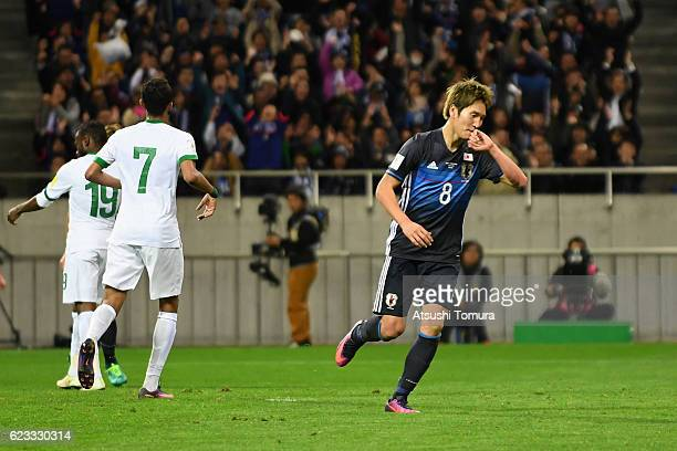Genki Haraguchi of Japan celebrates scoring his team's second goal during the 2018 FIFA World Cup Qualifier match between Japan and Saudi Arabia at...