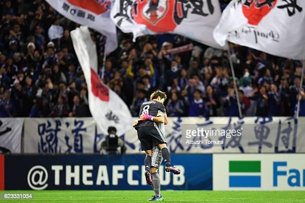 Genki Haraguchi of Japan celebrates scoring his team's second goal with his team mate Shusaku Nishikawa during the 2018 FIFA World Cup Qualifier...