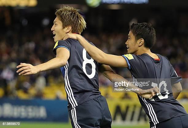 Genki Haraguchi of Japan celebrates with Shinji Kagawa after scoring a goal during the 2018 FIFA World Cup Qualifier match between the Australian...