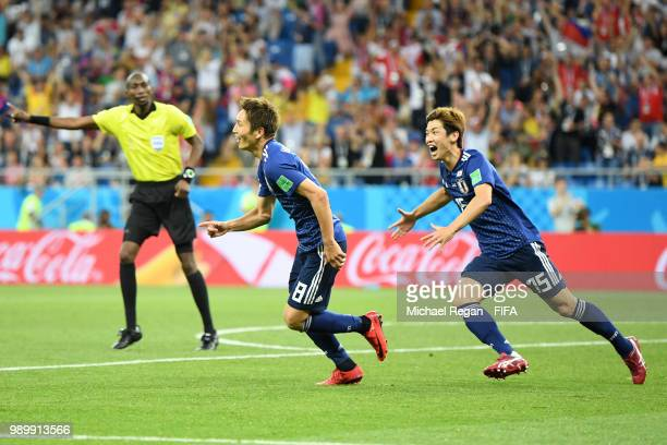 Genki Haraguchi of Japan celebrates with team mate Yuya Osako after scoring his team's first goal during the 2018 FIFA World Cup Russia Round of 16...