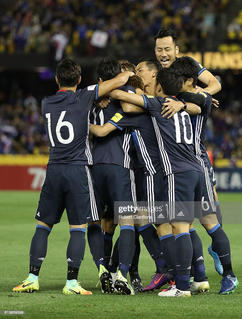 Genki Haraguchi of Japan celebrates with team mates after scoring a goal during the 2018 FIFA World Cup Qualifier match between the Australian Socceroos and Japan at Etihad Stadium on October 11, 2016 in Melbourne, Australia.