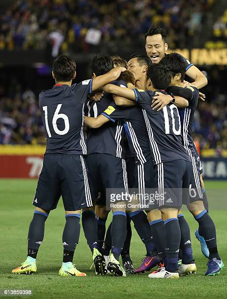 Genki Haraguchi of Japan celebrates with team mates after scoring a goal during the 2018 FIFA World Cup Qualifier match between the Australian...
