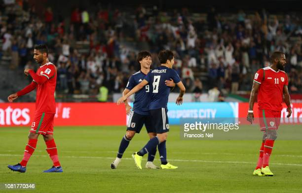 Genki Haraguchi of Japan celebrates with teammate Takumi Minamino after scoring his team's first goal from the penalty spot during the AFC Asian Cup...