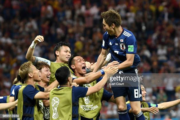 Genki Haraguchi of Japan celebrates with teammates after scoring his team's first goal during the 2018 FIFA World Cup Russia Round of 16 match...