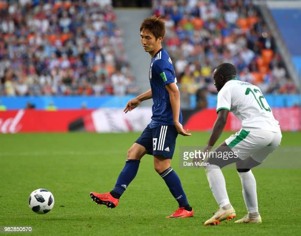 Genki Haraguchi of Japan is challenged by Abdoulaye Diallo of Senegal during the 2018 FIFA World Cup Russia group H match between Japan and Senegal...