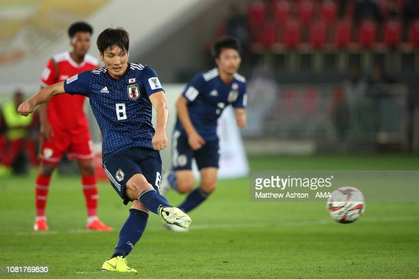 Genki Haraguchi of Japan scores his side's first goal to make the score 01 during the AFC Asian Cup Group F match between Oman and Japan at Zayed...