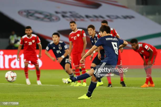 Genki Haraguchi of Japan scores his team's first goal from the penalty spot during the AFC Asian Cup Group F match between Oman and Japan at Zayed...
