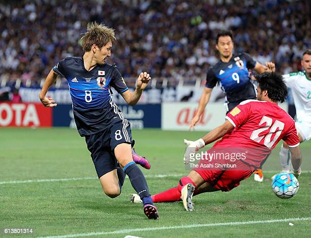Genki Haraguchi of Japan scores the first goal during the 2018 FIFA World Cup Qualifiers match between Japan and Iraq at Saitama Stadium on October 6...