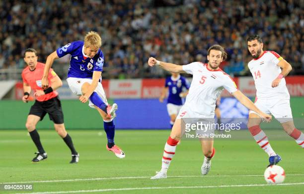Genki Haraguchi of Japan shoots at goal during the international friendly match between Japan and Syria at Tokyo Stadium on June 7 2017 in Chofu...