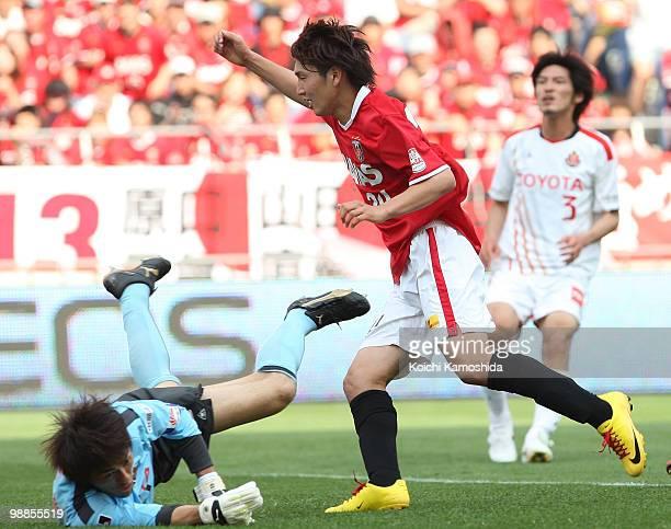 Genki Haraguchi of Urawa Red Diamonds celebrates after scoring his goal during the J. League match between Urawa Red Diamonds and Nagoya Grampus at...