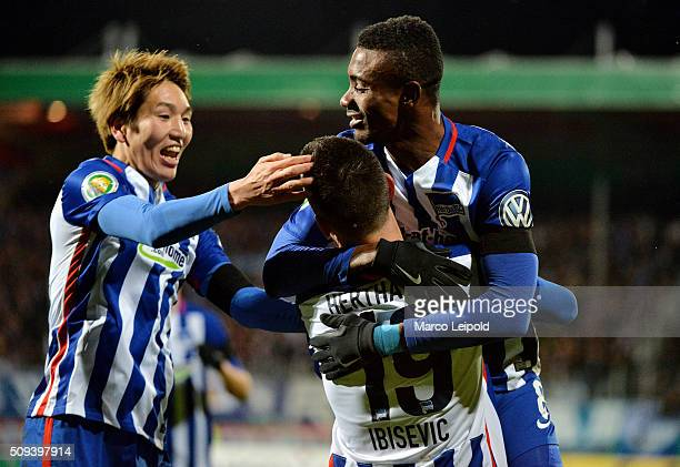 Genki Haraguchi Vedad Ibisevic and Salomon Kalou of Hertha BSC celebrate after scoring the 11 during the cup match between 1 FC Heidenheim and Hertha...