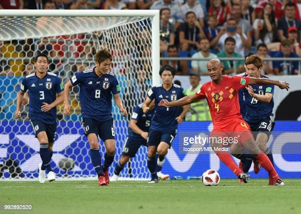 Genki Haraguchi Vincent Kompany and Yuya Osako pictured in action during the 2018 FIFA World Cup Russia Round of 16 match between Belgium and Japan...
