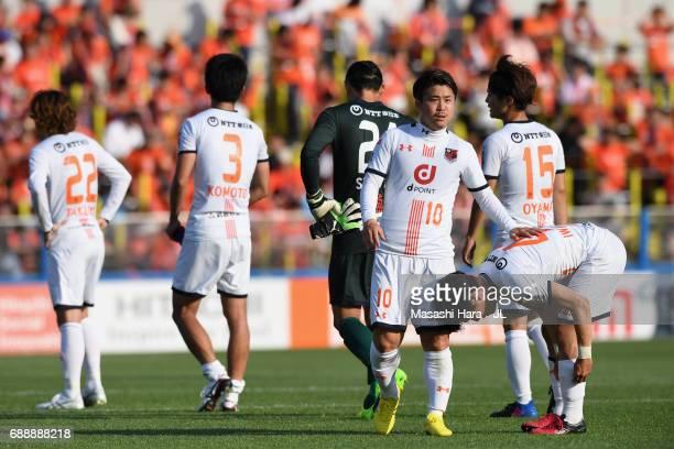 Genki Omae of Omiya Ardija consoles Yusuke Segawa after their 24 defeat in the JLeague J1 match between Kashiwa Reysol and Omiya Ardija at Hitachi...