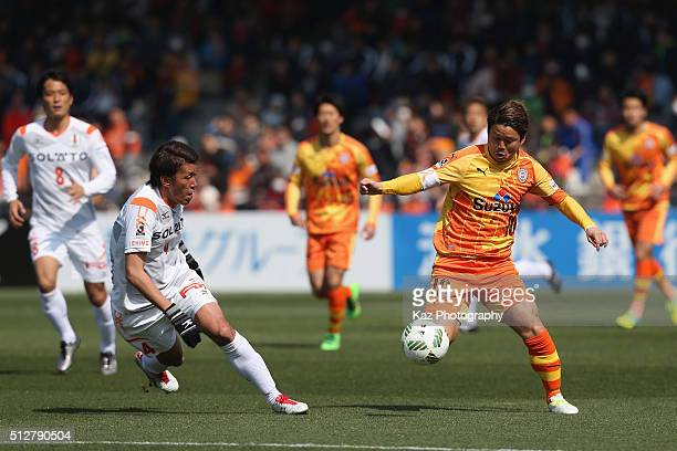 Genki Omae of Shimizu SPulse and Daiki Nishioka of Ehime FC compete for the ball during the JLeague second division match between Shimizu SPulse and...