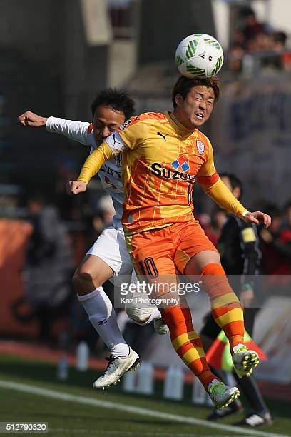 Genki Omae of Shimizu SPulse and Ibuki Fujita of Ehime FC compete for the ball during the JLeague second division match between Shimizu SPulse and...