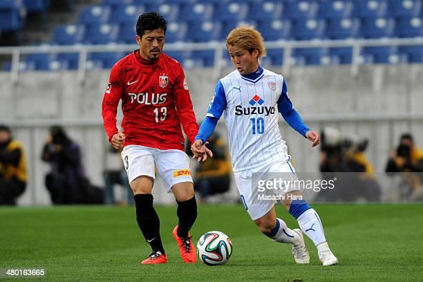 Genki Omae of Shimizu SPulse and Keita Suzuki of Urawa Red Diamonds compete for the ball during the JLeague match between Urawa Red Diamonds and...