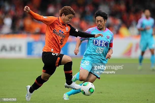 Genki Omae of Shimizu SPulse and Yoshiki Takahashi of Sagan Tosu compete for the ball during the JLeague match between Shimizu SPulse and Sagan Tosu...