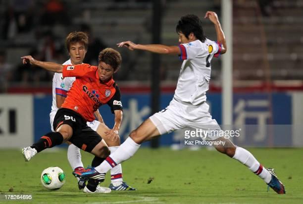 Genki Omae of Shimizu SPulse competes for the ball against Kazuya Yamamura and Takahide Umebachi of Kashima Antlers during the JLeague match between...