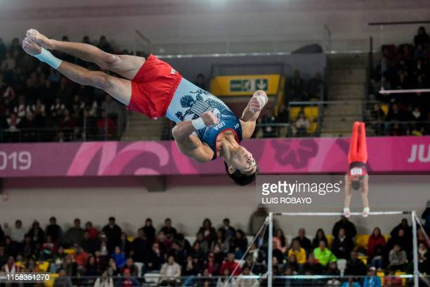 US Genki Suzuki competes in the Floor during the Men's Team Qualification and Team final at the Lima 2019 PanAmerican Games in Lima on July 28 2019