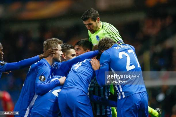 Genk's Alejandro Pozuelo celebrates with teammates after scoring during the UEFA Europa League return leg of the 1/16 finals football match between...