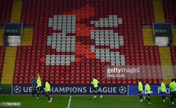RC Genk's Belgian defender Sebastien Dewaest and RC Genk's Tanzanian forward Mbwana Ally Samatta attends a training session at Anfield stadium in...