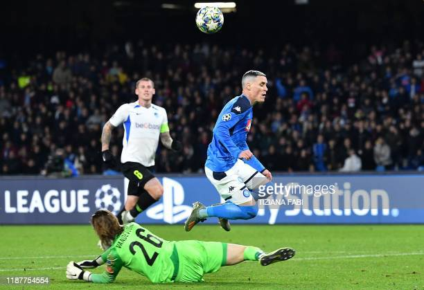RC Genk's Belgian goalkeeper Maarten Vandevoordt fouls Napoli's Spanish forward Jose Callejon in the penalty area during the UEFA Champions League...