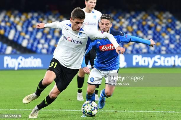 Genk's Danish defender Joakim Maehle outruns Napoli's Belgian forward Dries Mertens during the UEFA Champions League Group E football match Napoli vs...