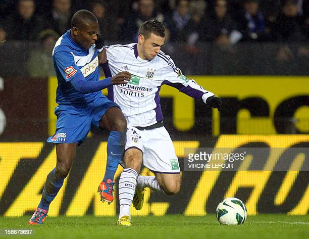 Genk's Derrick Tshimanga and Anderlecht's Massimo Bruno fight for the ball during the Jupiler Pro League match between KRC Genk and RSCA Anderlecht...