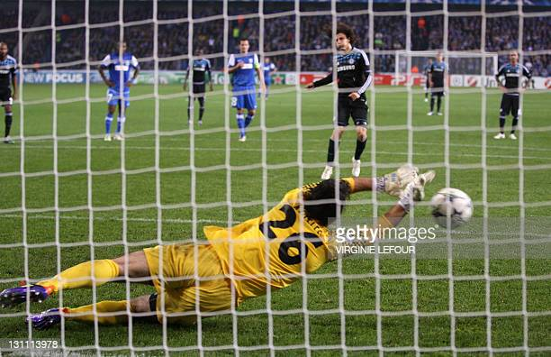 Genk's goalkeeper Laszlo Koteles stops a penalty kick of Chelsea's David Luiz during their UEFA Champions League Group E football match in Genk on...