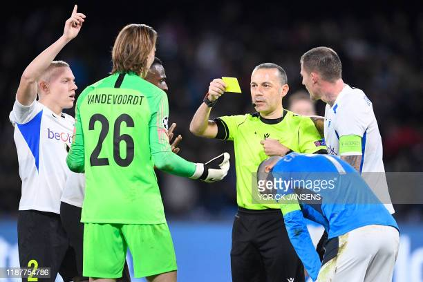 Genk's goalkeeper Maarten Vandevoordt receives a yellow card from referee Cuneyt Cakir during the game between Belgian soccer team KRC Genk and...