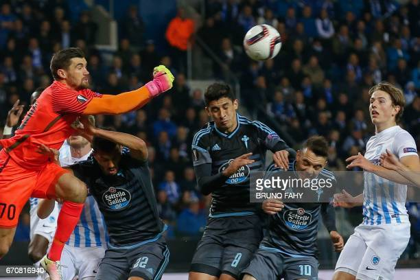 Genk's goalkeeper Mathew Ryan Celta's Gustavo Cabral Celta's John Guidetti Celta's Lago Aspas and Genk's Sander Berge fight for the ball during the...