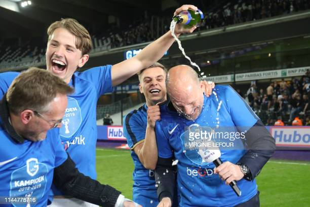 Genk's head coach Philippe Clement and his players pictured with champagne during celebrations of new champions KRC Genk, after a soccer match...