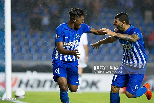 Genk's Jamaican forward Leon Bailey and Genk's Greek forward Nikolaos Karelis celebrate after scoring a goal during the UEFA Europa League football...