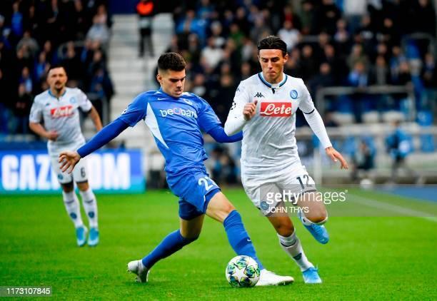 RC Genk's Japanese forward Junya Ito vies with Napoli's Spanish defender Fabian Ruiz during the UEFA Champions League Group E football match between...