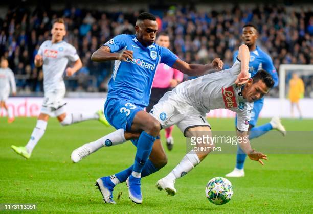 Genk's Jhon Lucumi Bonilla vies with Napoli's Hirving Lozano during the UEFA Champions League Group E football match between Napoli and RC Genk on...