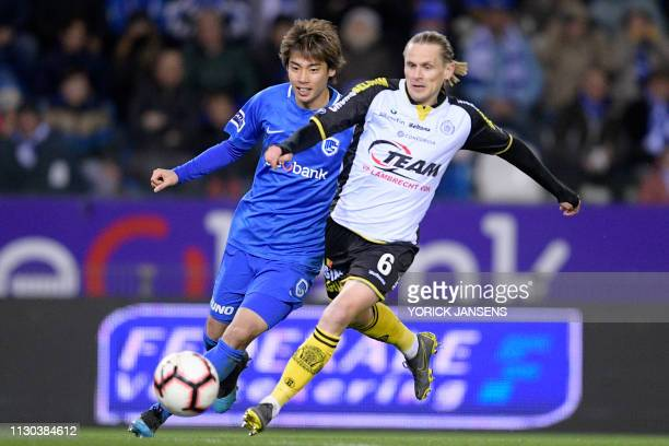 Genk's Junya Ito and Lokeren's Ari Freyr Skulason fight for the ball during a soccer match between KRC Genk and Sporting Lokeren Sunday 10 March 2019...