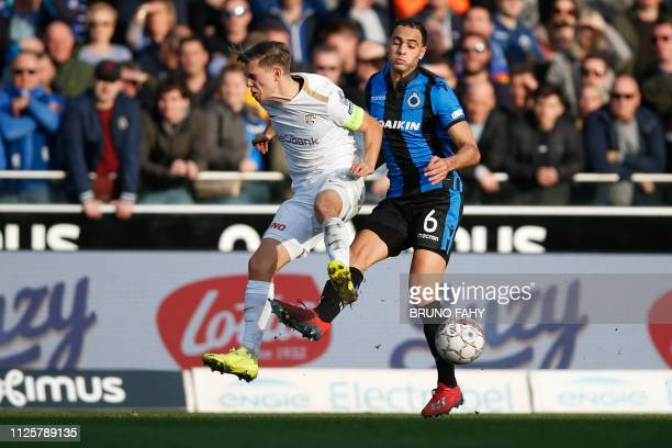 Genk's Leandro Trossard and Club's Sofyan Amrabat fight for the ball during a soccer game between Club Brugge KV and KRC Genk Sunday 17 February 2019...