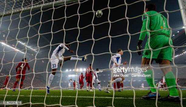 Genk's Mbwana Samatta scores past Liverpool's Alisson Becker during the UEFA Champions League group E match between Liverpool FC and KRC Genk at...