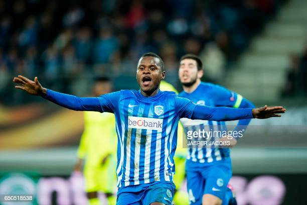 Genk's Mwbana Ally Samatta celebrates after scoring a goal during the UEFA Europa League round of 16 football match between KAA Gent and KRC Genk in...