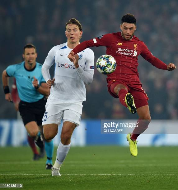 RC Genk's Norwegian midfielder Sander Berge ceompetes with Liverpool's English midfielder Alex OxladeChamberlain during the UEFA Champions League...